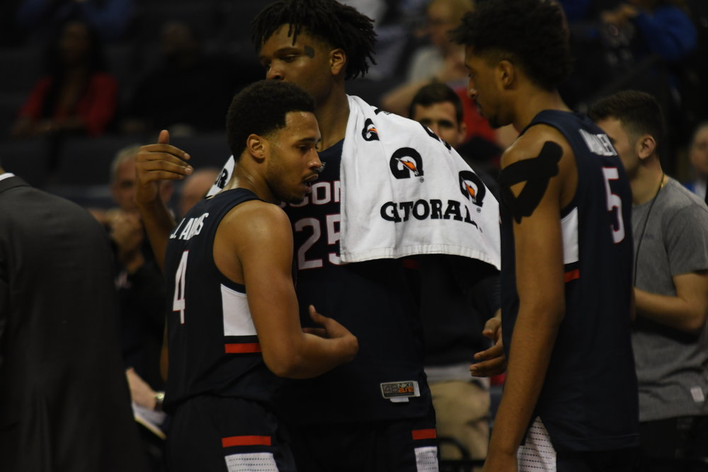 Jalen Adams and Josh Carlton share a moment after Adams was taken out with 51 seconds left in UConn's 84-45 loss to Houston in the second round of the American Athletic Conference Tournament on Friday, March 15 at the FedEx Forum in Memphis, Tenn. (Judah Shingleton/The Daily Campus)
