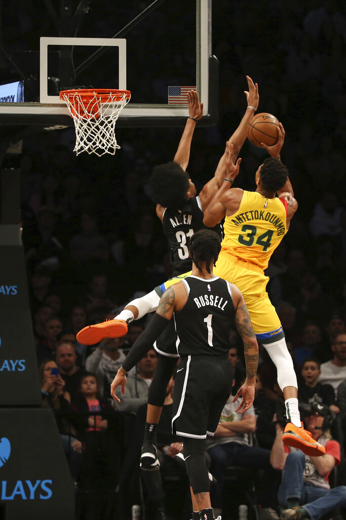 Brooklyn Nets center Jarrett Allen (31) attempts to block Milwaukee Bucks forward Giannis Antetokounmpo (34) during the first half of an NBA basketball game, Monday, April 1, 2019, in New York. (AP Photo/Michael Owens)