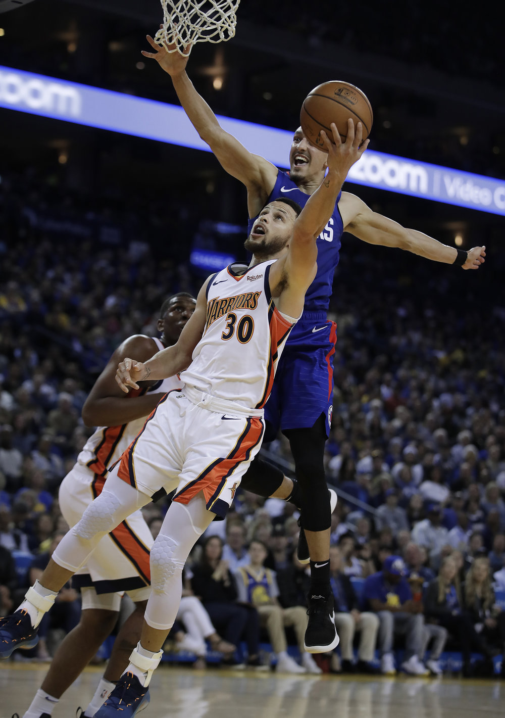 Golden State Warriors' Stephen Curry (30) shoots against Los Angeles Clippers' Landry Shamet during the second half of an NBA basketball game Sunday, April 7, 2019, in Oakland, Calif. (AP Photo/Ben Margot)