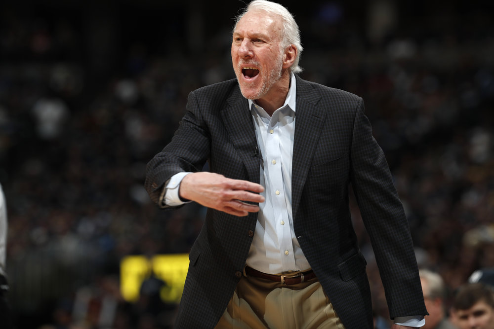 3823f6627bd5 San Antonio Spurs head coach Gregg Popovich directs his team against the  Denver Nuggets in the