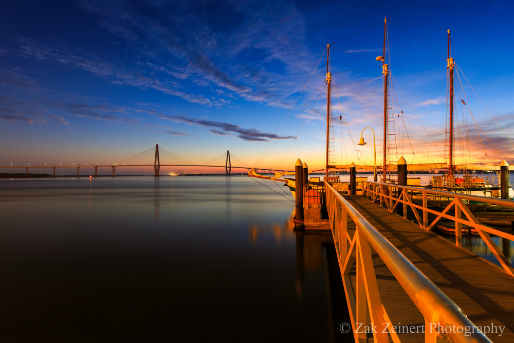Early morning photo of the harbor with the Arthur Ravenel Bridge in the distance