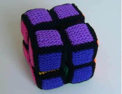 This is a knit version of a  popular toy. It is made up from eight cubes, joined in a special way. you can fold and unfold the large cube continuously to reveal several different faces. There is also a crochet version available.