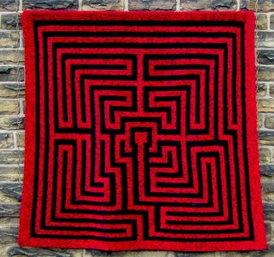 Amazement:   a knitted maze. Photograph: Pat Ashforth; PERSONAL THOUGHT: THAT CENTER FORMATION MAKES ME THINK OF A KEITH Haring figure.
