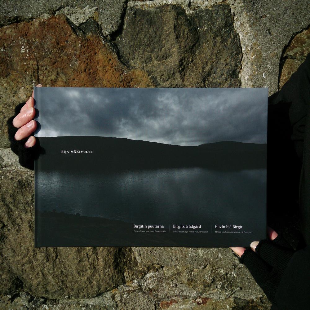 © Eija Mäkivuoti: Birgit's Garden book cover in the sun light of Tórshavn,2015.   BIRGIT'S GARDEN, BIRGITIN PUUTARHA, BIRGITS TRÄDGÅRD, HAVIN HJÁ BIRGIT    My Wondrous Journeys to the Faroe Islands, Ihmeelliset matkani Färsaarille, Mina märkliga resor till Färöarna, Mínar undursomu ferðir til Føroyar      A Nordic photo book about the Faroe Islands by Eija Mäkivuoti.