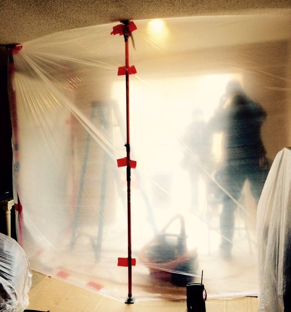 MIRAK AND ANTONIO INSTALLING AN INTEGRITY SLIDING GLASS DOOR IN FEBRUARY.