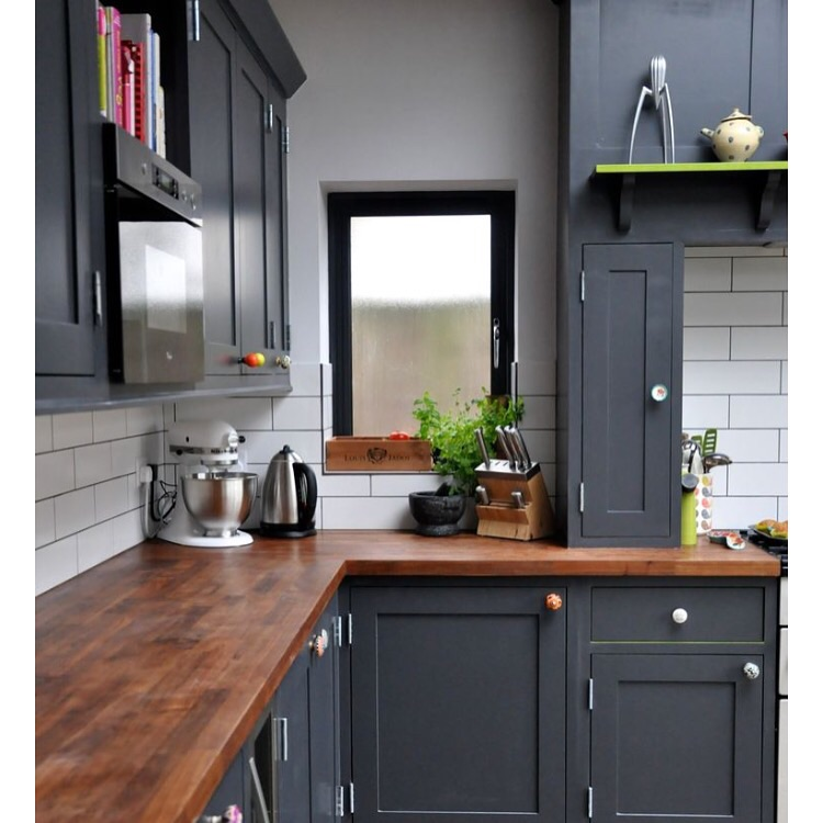 Charcoal Cabniets with wood counters make a bold contrast.