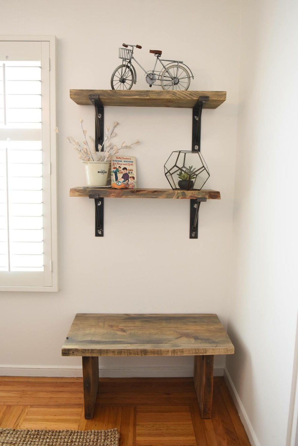 Accent items like benches and shelves can be added to tie the wood countertops in to the space.