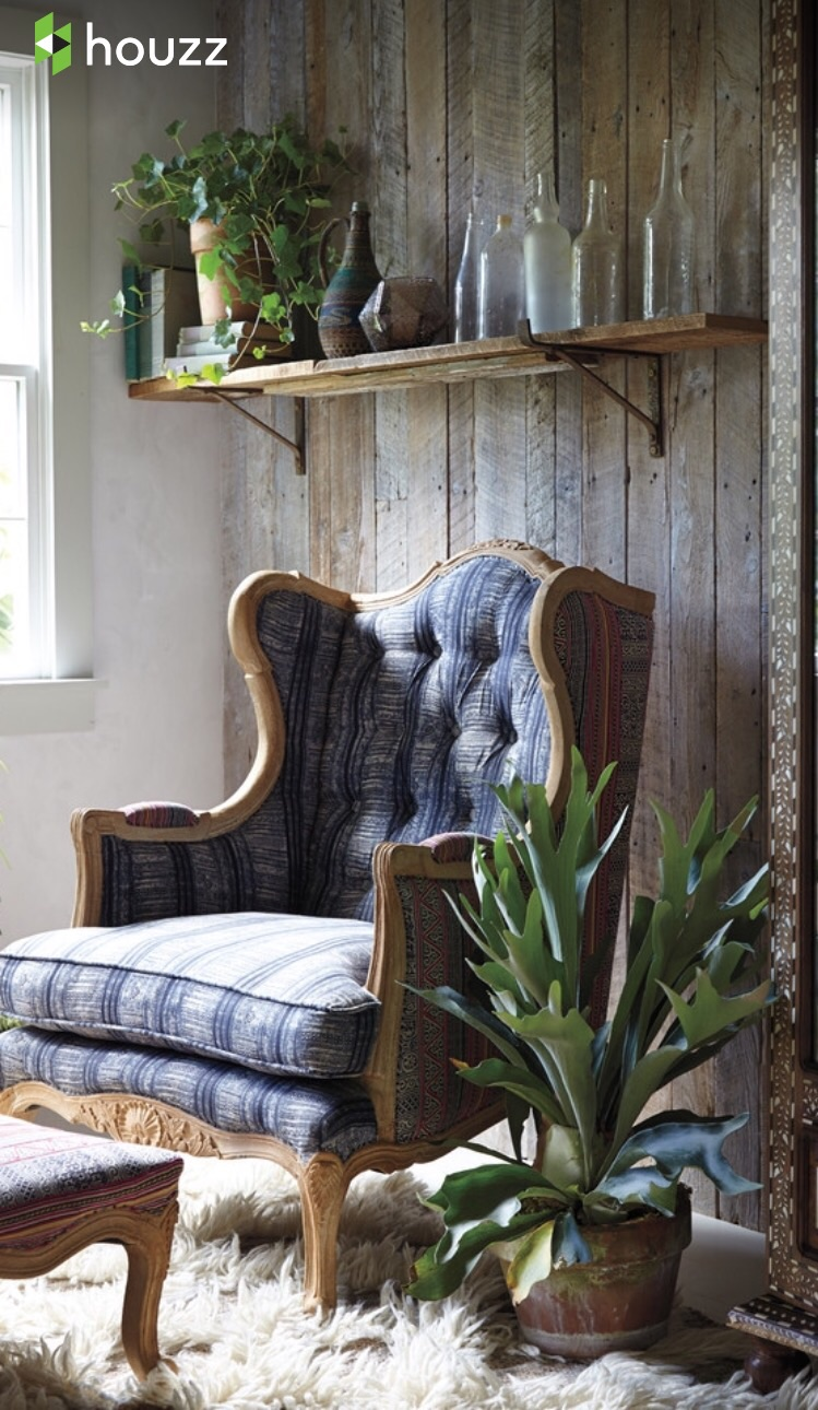 Traditional navy wing back and Rustic wood wall treatment meet up and create a comfy style. Rustic elegant boho pairing.