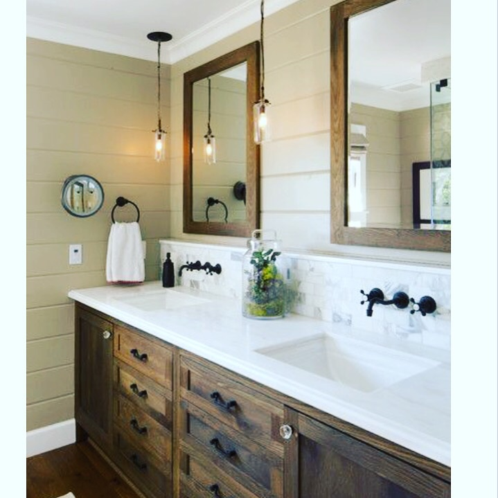 Rustic dark wood cabinets and painted shiplap make for a warm space. Photo credit: Houzz