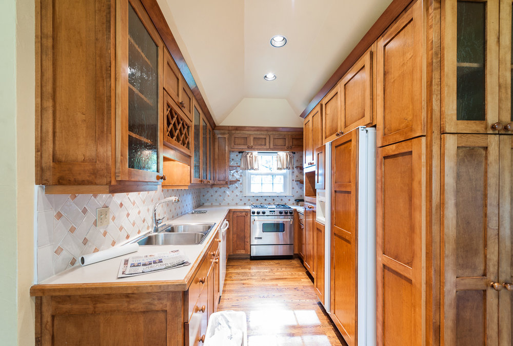The old oaky kitchen had beautiful wood, but now it is time for cleaner white elements.