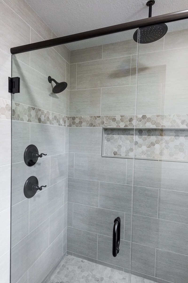 The hardware was updated to oiled bronze to keep with some rustic feel. It also serves to create a bold contrast to the lighter colored tile.