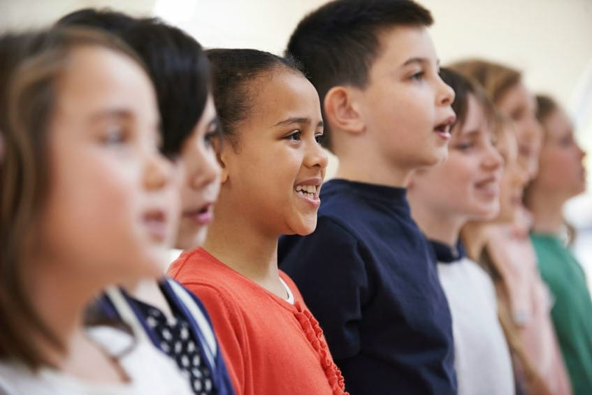 Group-Of-School-Children-Singing-In-Choir-Together.jpg