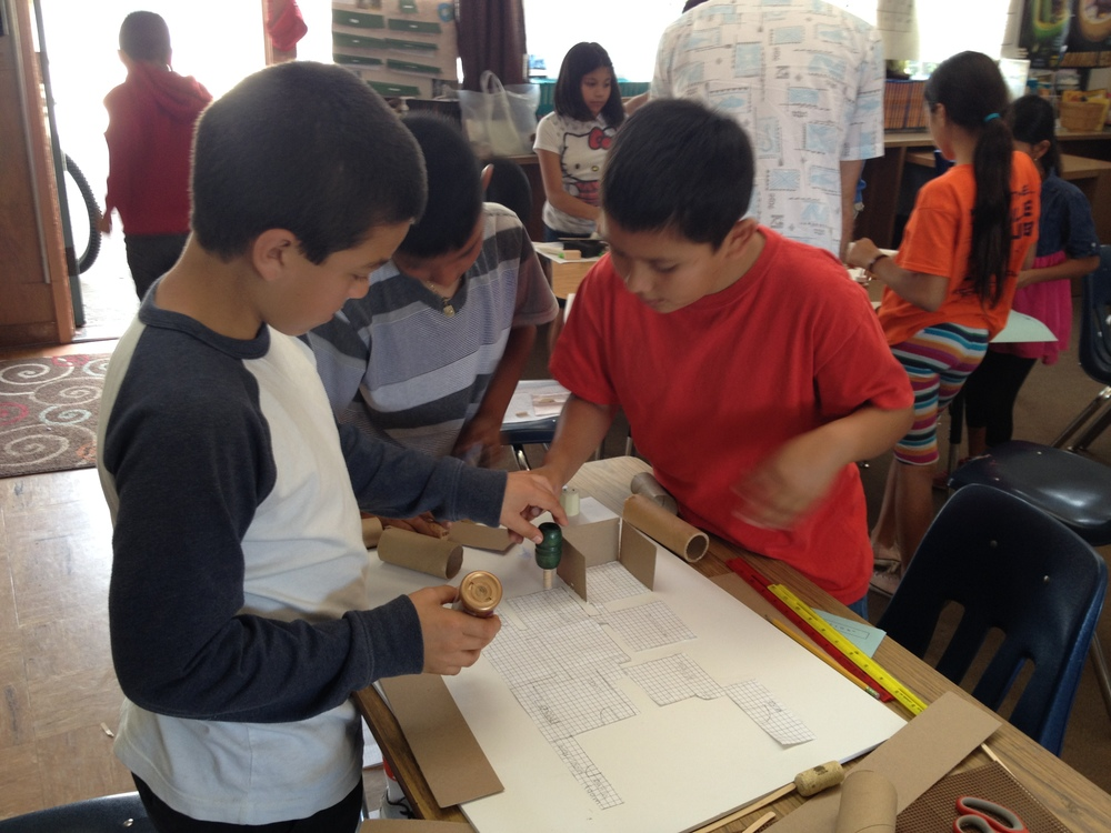 STUDENTS BUILDING THEIR MODEL FROM A FLOOR PLAN.