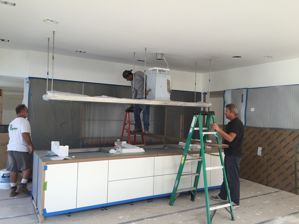 INSTALLATION OF AN 11' KITCHEN HOOD IN THE BULTHAUP KITCHEN.