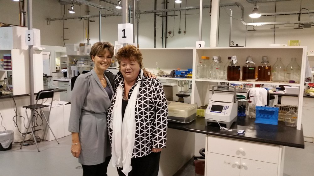 Pictured: The Hon. Linda Reid beside Dr. Sandra Dunn at the PhoenixMD Labs in Richmond.