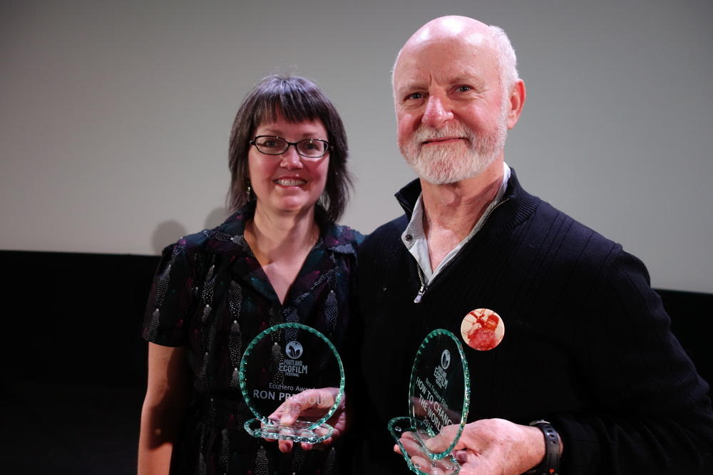 "Fest Director Dawn Smallman presents the 2015 EcoHero Award to Ron Precious, original Greenpeace expedition cinematographer, and Best Feauture Award to ""How To Change The World"""