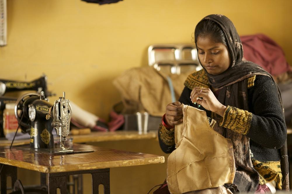 Renu Das, (widowed) single mother of 2 kids