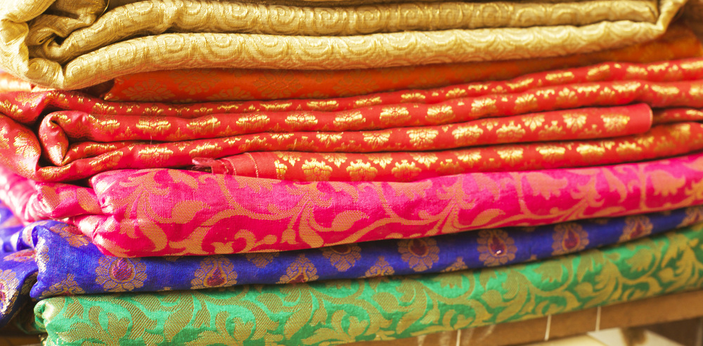 Upon entering one of the local textile shops, our focus was to find pieces similar to the vintage saris Reshma's grandmother generously donated in an effort to support our cause. Luckily, we stumbled across some of the most vibrant colored, uniquely patterned pieces of fabric!