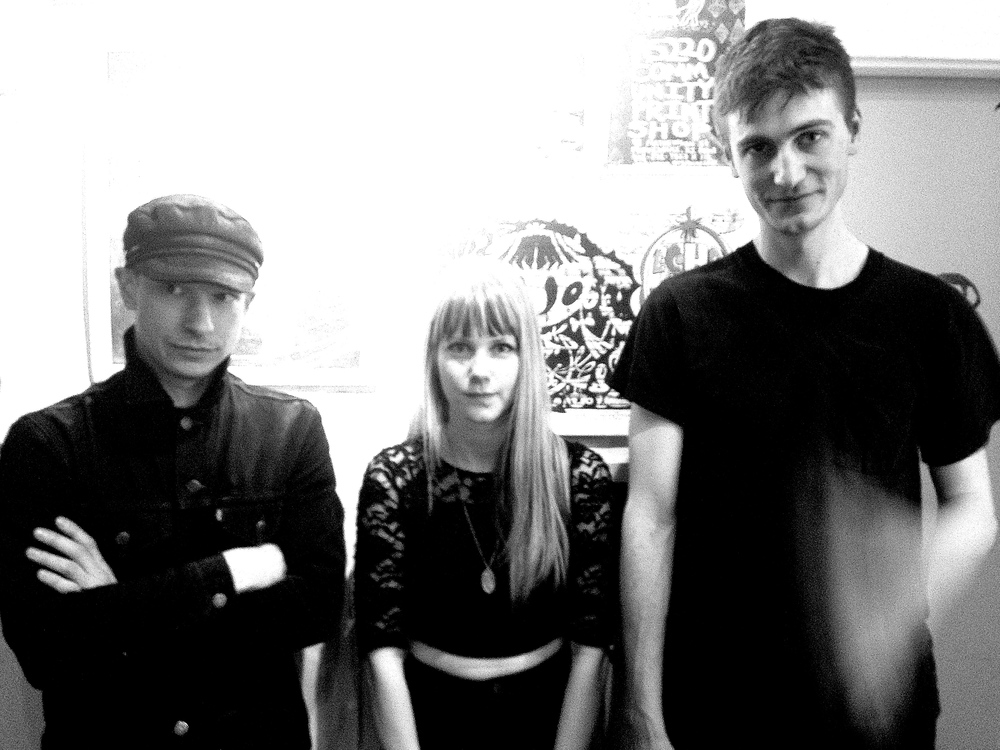 From left to right: bassist Nicholas Sadler, drummer Anna Wingfield, and vocalist / lead guitarist Derek Knox.