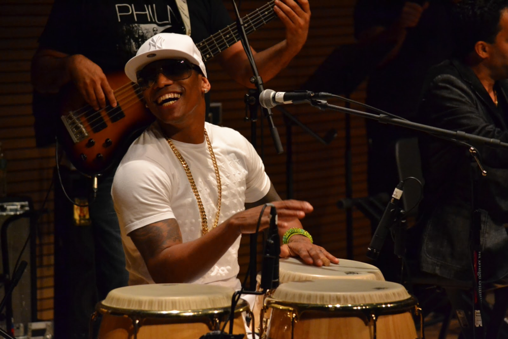 Pedrito Martinez smiling with fellow band members during the Day of Orula Celebration.