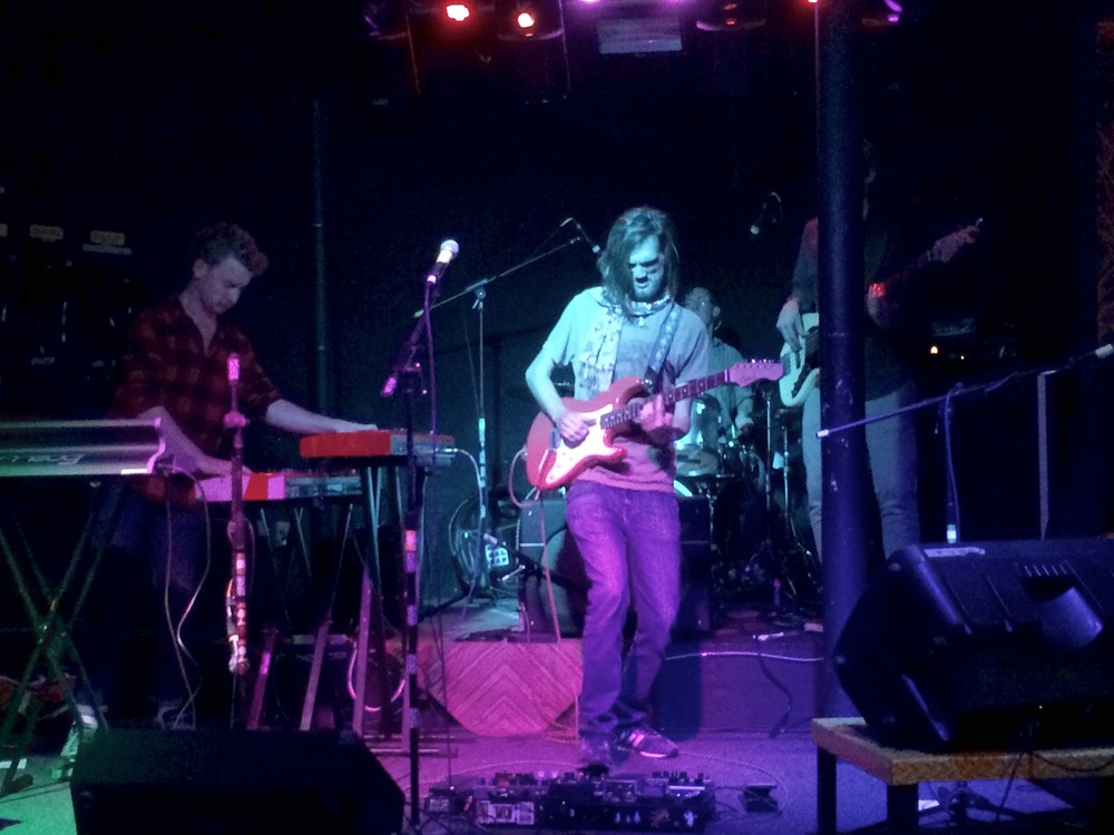 Zach Cross (left) and Killian Karlsson (center) performing with Mammal Dap at The Spot Underground