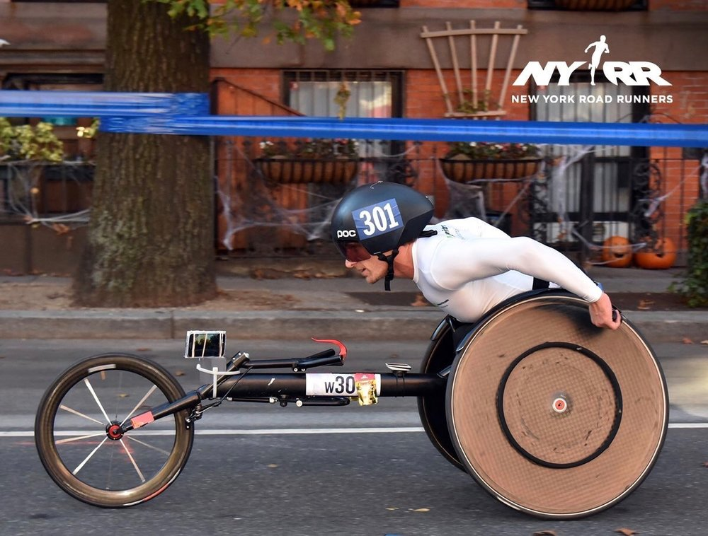 The original camera system we tested was based around a Samsung cell phone so that we could harness the wifi capabilities and battery life of the device. For the 2016 NYC Marathon the phone was fixed to the front of my frame and the only part of me you could see was my front wheel. For the NYC Half Marathon we used a custom built camera mounted on the back of my chair to offer a more dynamic POV shot.