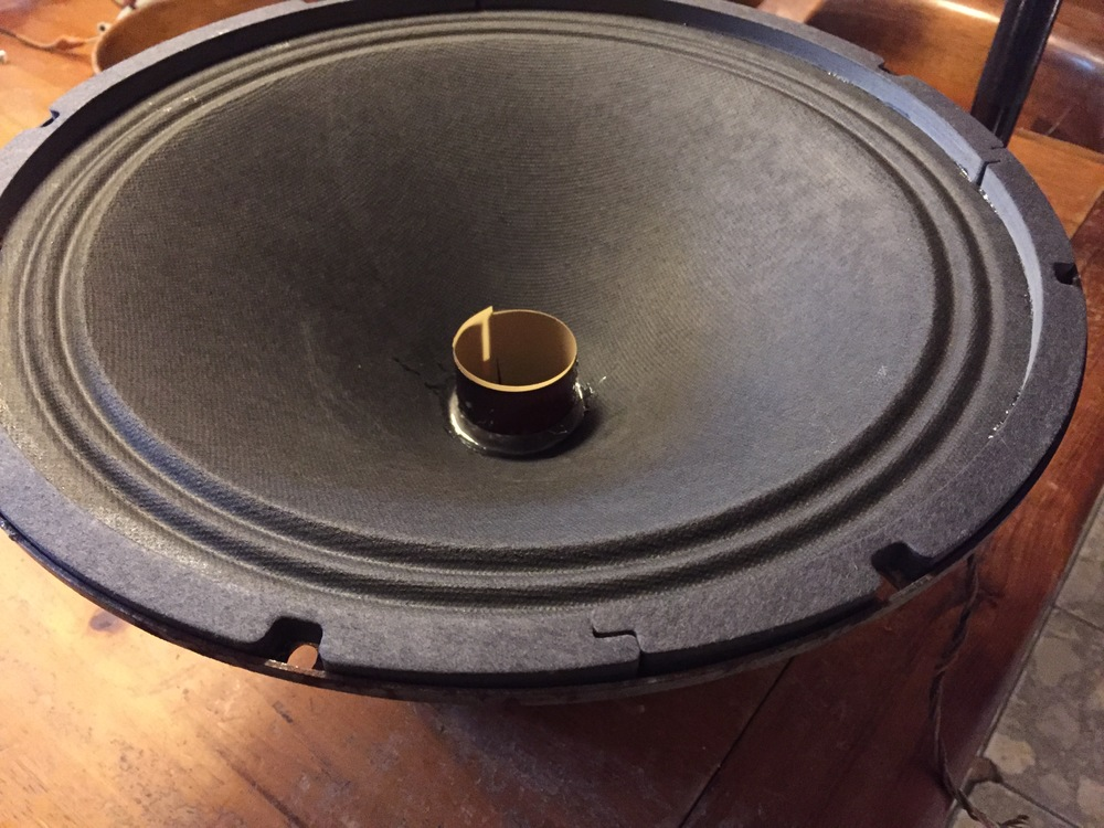 Cone cemented in place, over new voice coil and spider. New gasket material,  temporary spacer.
