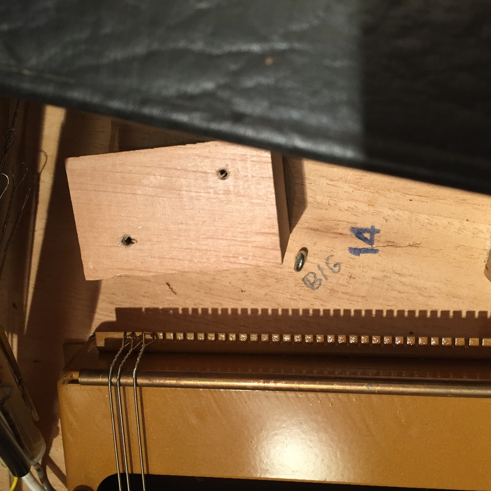 The bridge end of the new strings.