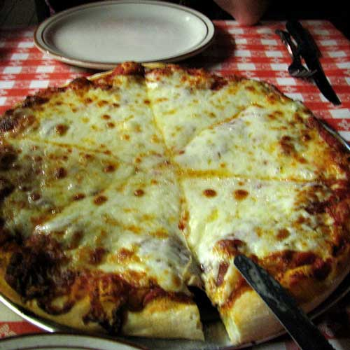 Lots and lots of cheese at Filippis Pizza Grotto.