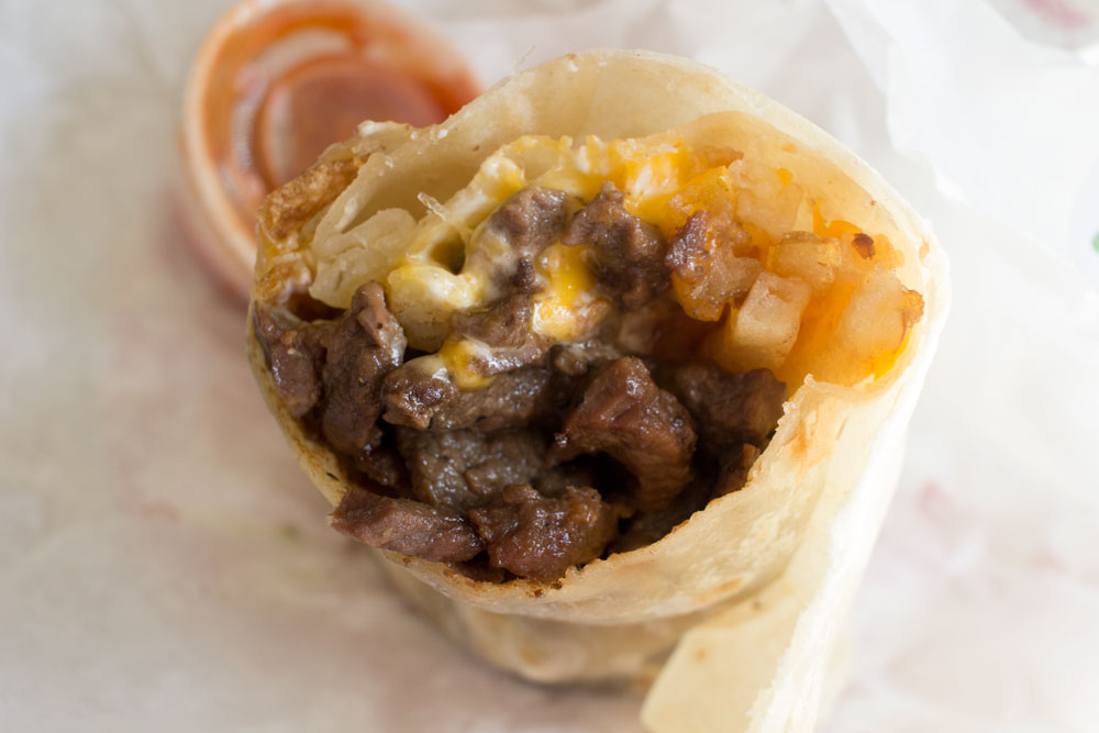 Bite into this California Burrito when you are in San Diego. See how moist and succulent the meat is?