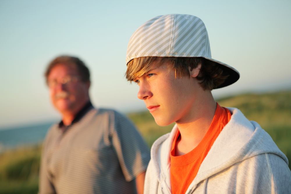 bigstock-Serious-teen-with-father-55185782.jpg