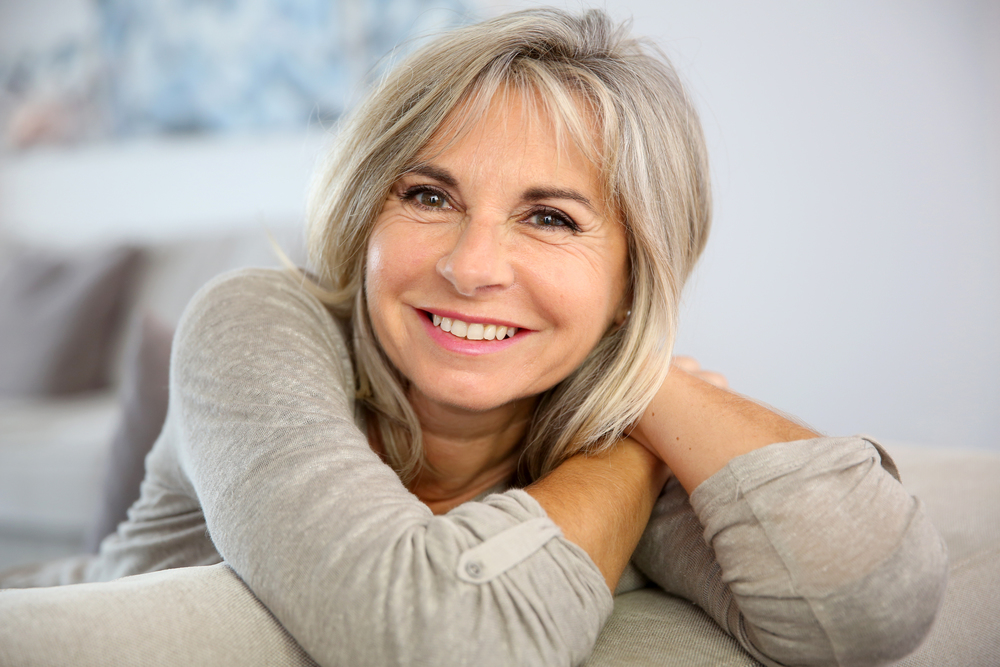 bigstock-Smiling-senior-woman-sitting-i-54482024.jpg