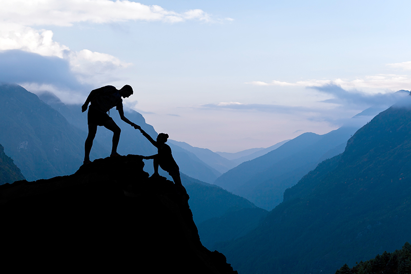 bigstock-Teamwork-Couple-Climbing-Helpi-91037114 small.jpg