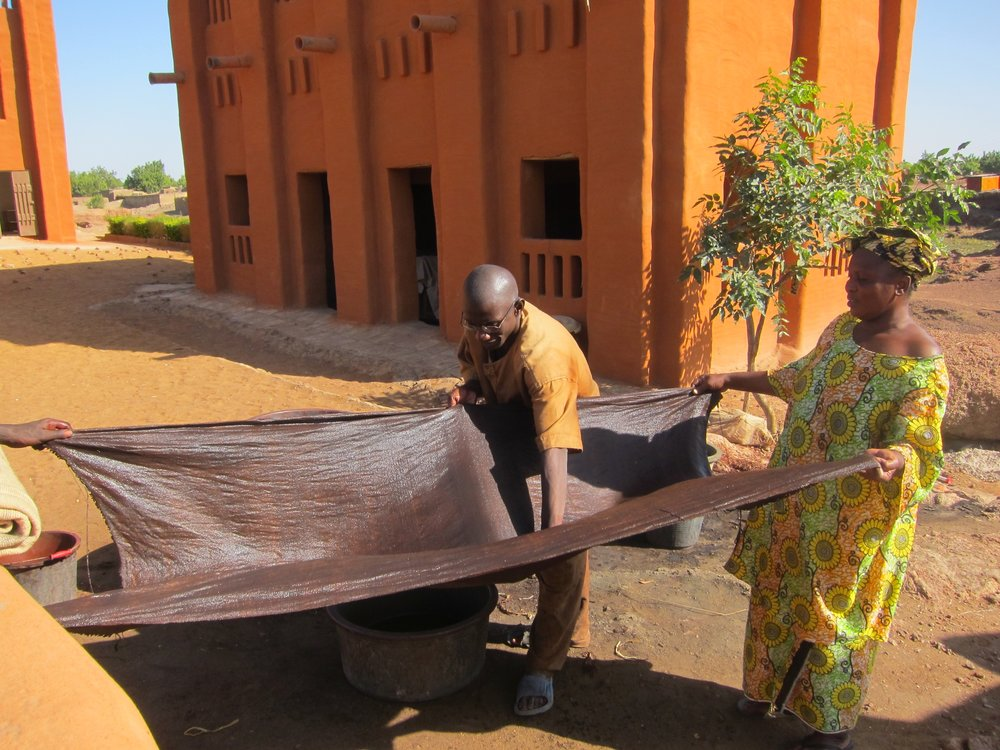 Proud Mary Global Textiles Applying Mud Mali.jpg