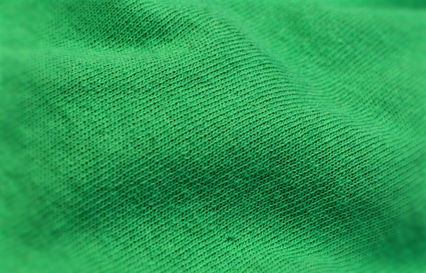 Regular cotton has a looser weave and more texture to the individual threads.