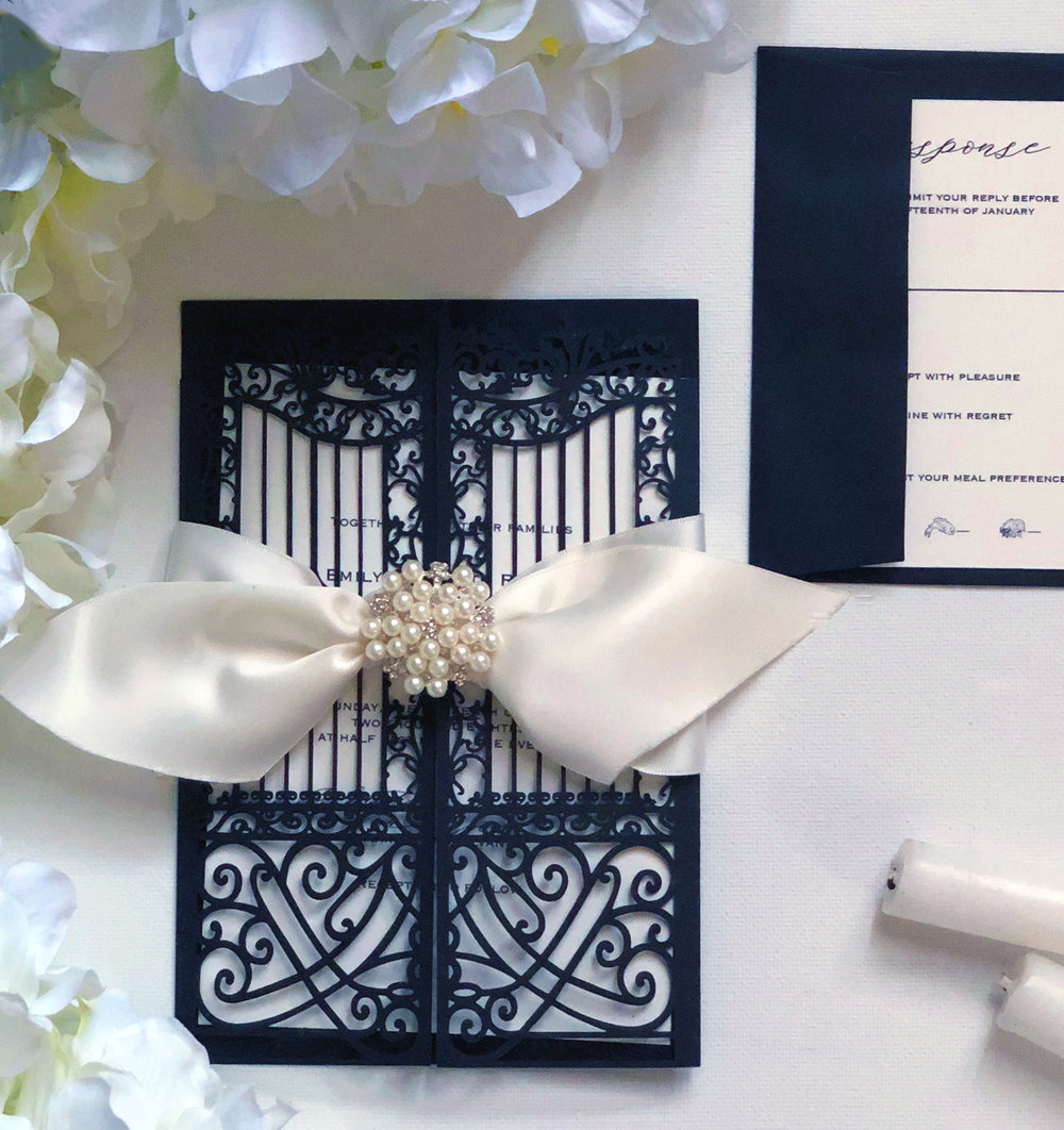 Laser Cut Invitations  Whether a simple or intricate pattern, laser cutting is sure to wow your guests. This method allows you to create beautiful shapes with precise details. This invitation style is available in flat laser cut cards, glitter laser invitations, foil invitations, laser pockets and laser envelopes.