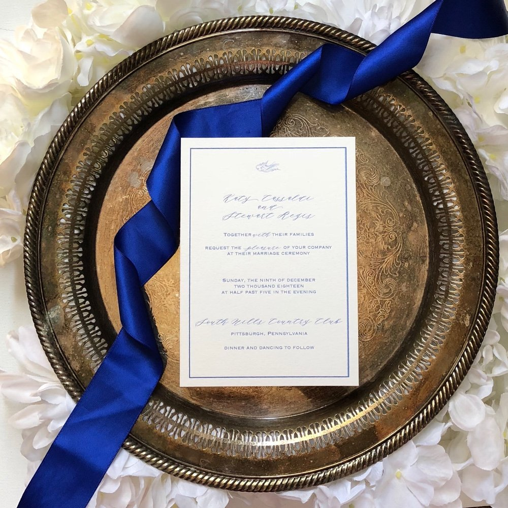 Classic  Add a pop of color or texture to your invitations with a layer of cardstock. A navy blue linen or a rose gold glitter layer, can take your invitation suit to the next level. This style is a good choice for a classic and simple event. Layered cards look great when kept secure by a belly band.