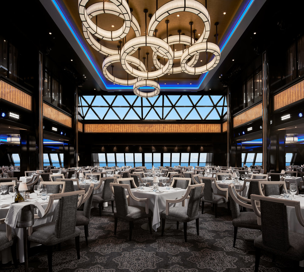 "The Manhattan Dining Room on the Norwegian Bliss. This was one of the larger files of the bunch as it required all of these tables to be lit individually, and stitching the light fixture from a different plate captured with my tilt-shift lens. The ship was also docked in port while we took this shot, so the ""view"" had to be replaced with what it would look like if the ship were at sea."