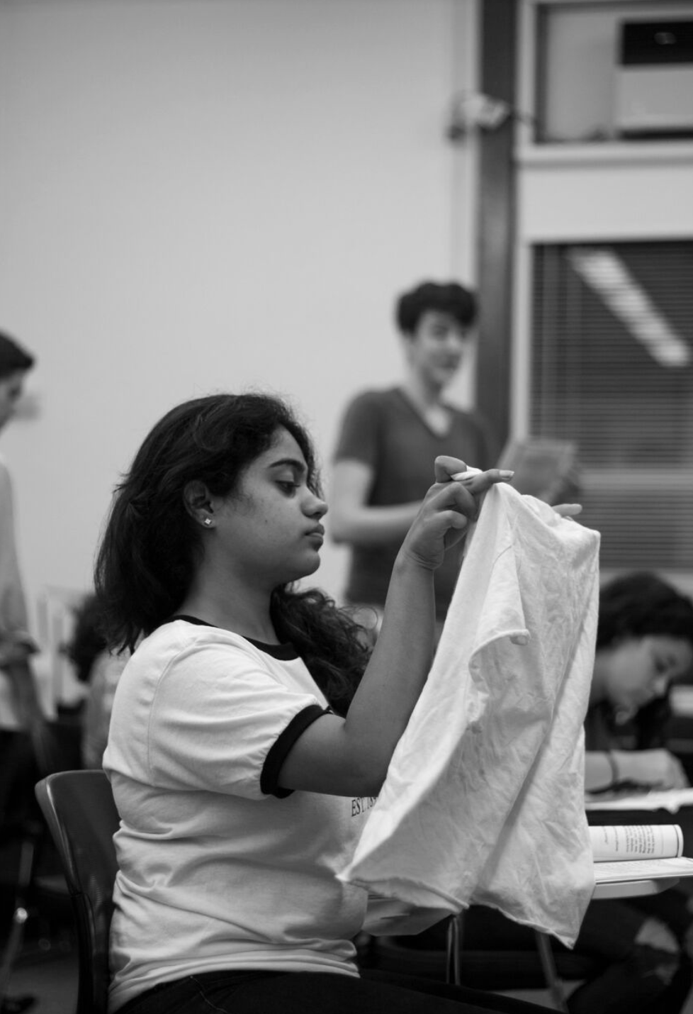 "Anushka Jain as ""Sewing Lady"" in Purple Crayon Players presents: Anon(ymous) by Naomi Iizuka.  ""Blue jeans t-shirts yoga pants…""   Ellie Levine Photography"