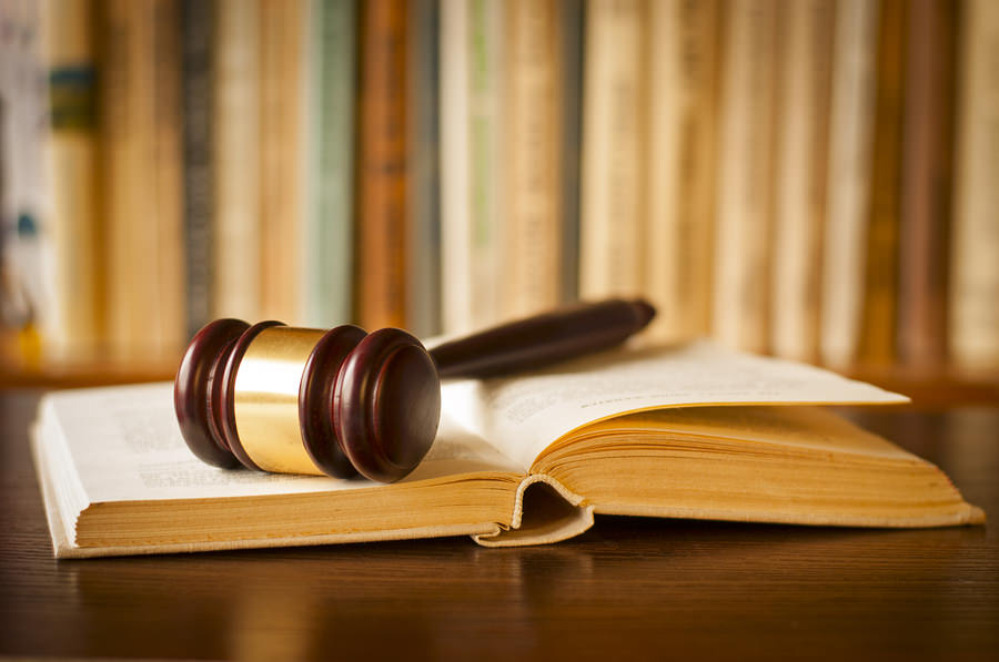 Open-Law-Book-With-A-Judges-Ga