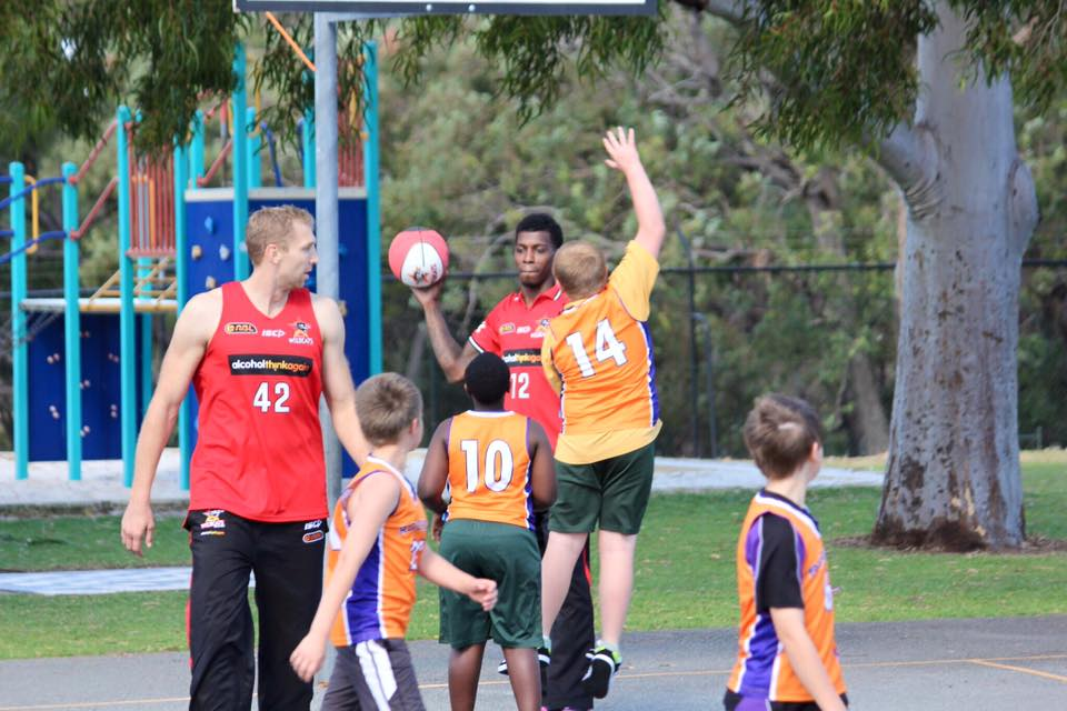 A North Balga Rockets player doing his best to block