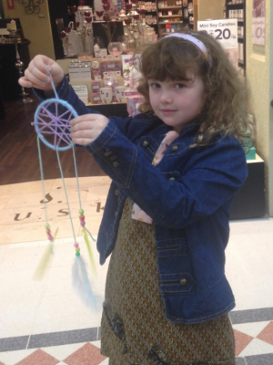 With a decorated dream catcher  (photo used with permission)