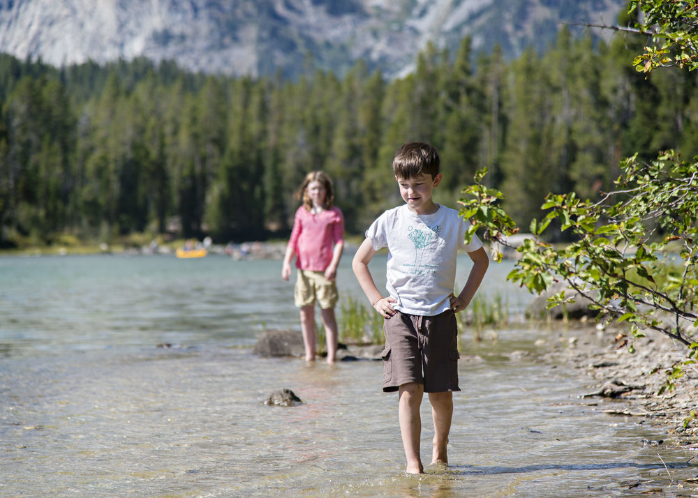 Parker and Samantha play in String Lake, Grand Teton National Park.  Nikon D800, Nikkor 24-120mm lens @ 120mm, ISO 200, f4, 1/600 sec.