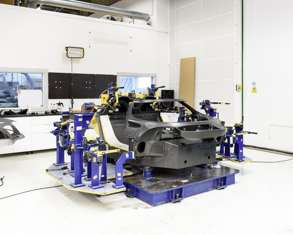 The start of the production line where the five main carbon fibre parts of the chassis are bonded together.