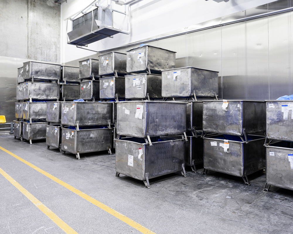 The off-cuts of meat arrive from the slaughterhouse in these metal bins. You see my series from the slaughterhouse in Horsens, the main supplier to this factory, here