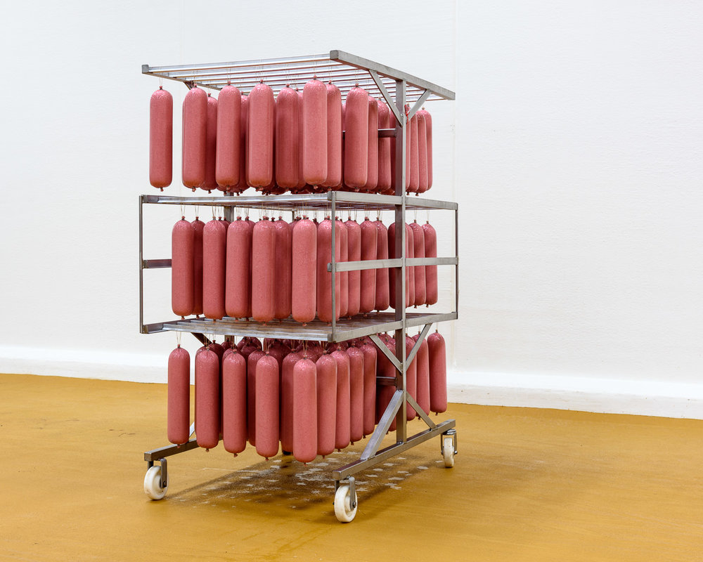 Freshly stuffed salami—weighing around three kilos each—before being cured and sliced, at Tulip's Gøl sausage factory in Svenstrup, Denmark.