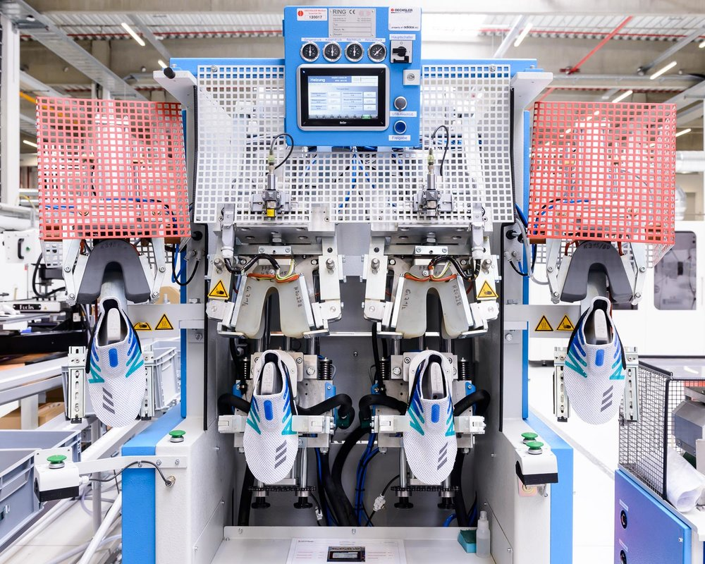 "adidas Made for London shoes in a lasting machine the company's new ""Speedfactory"" in Bavaria."