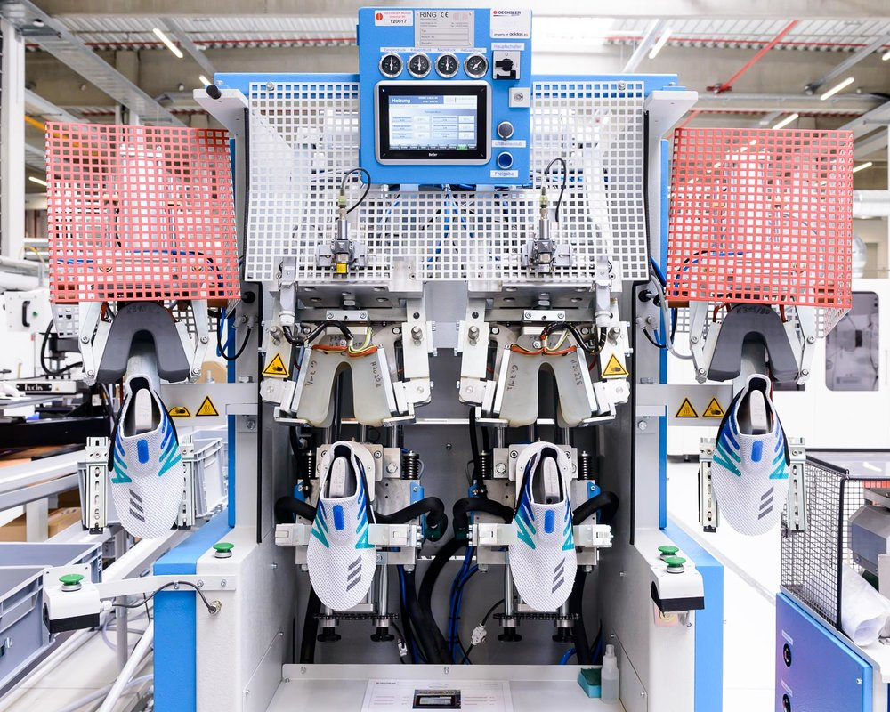 """adidas Made for London shoes in a lasting machine the company's new """"Speedfactory"""" in Bavaria"""