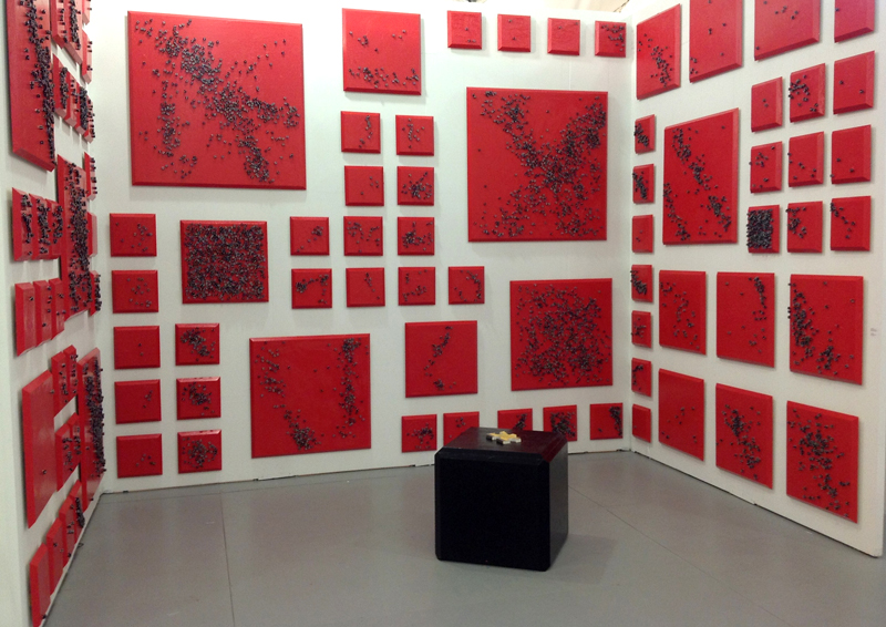 The Red and the Black, 2012. Installation view at Untitled Art Fair, Miami, 2012. Installation of 91 oil on wood and dice paintings 14 x 9 x 12 ft. Photo courtesy of Y Gallery.