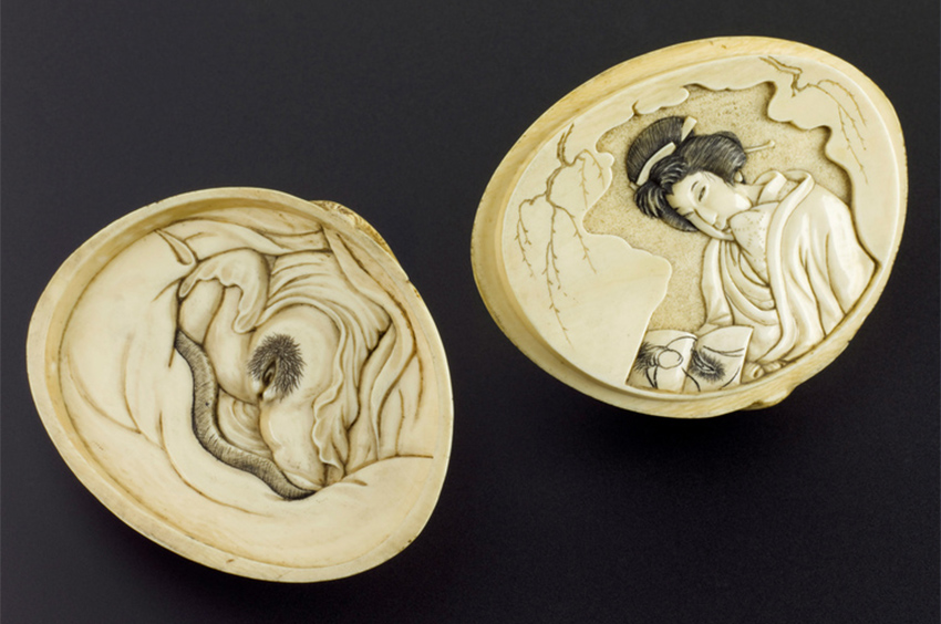 Ivory shell, divides into two halves, on one half is a female genitalia, on the other is a carving of a female looking at an erotic picture, Oriental, © Science Museum